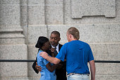 Clarence D Castile center uncle of Philando Castile consoles a woman outside the funeral for Philando at the Cathedral of St Paul on July 14 2016 in...