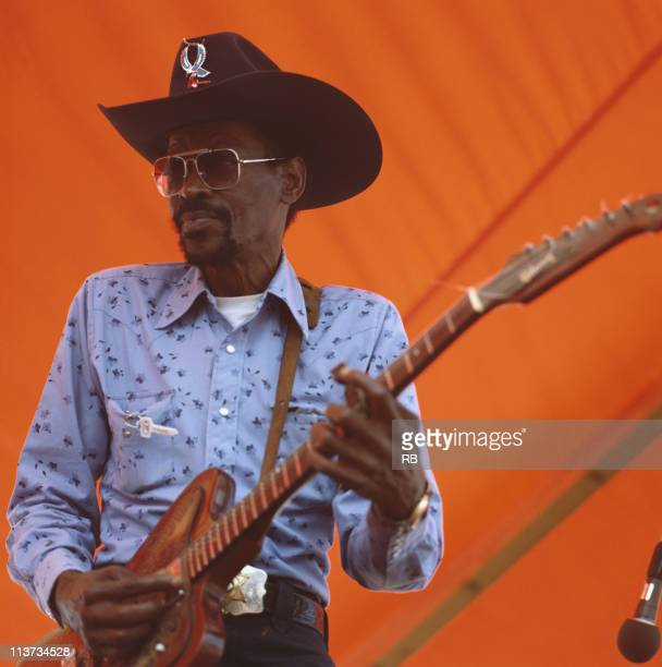 Clarence 'Gatemouth' Brown US blues guitarist playing the guitar during a live concert performance on stage at the New Orleans Jazz and Heritage...