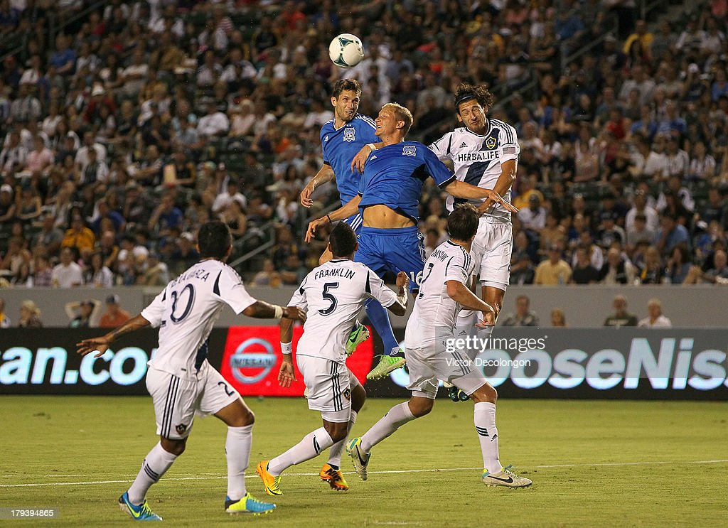 Clarence Goodson and Steven Lenhart of San Jose Earthquakes and Omar Gonzalez of Los Angeles Galaxy vie for the corner kick in the first half during...