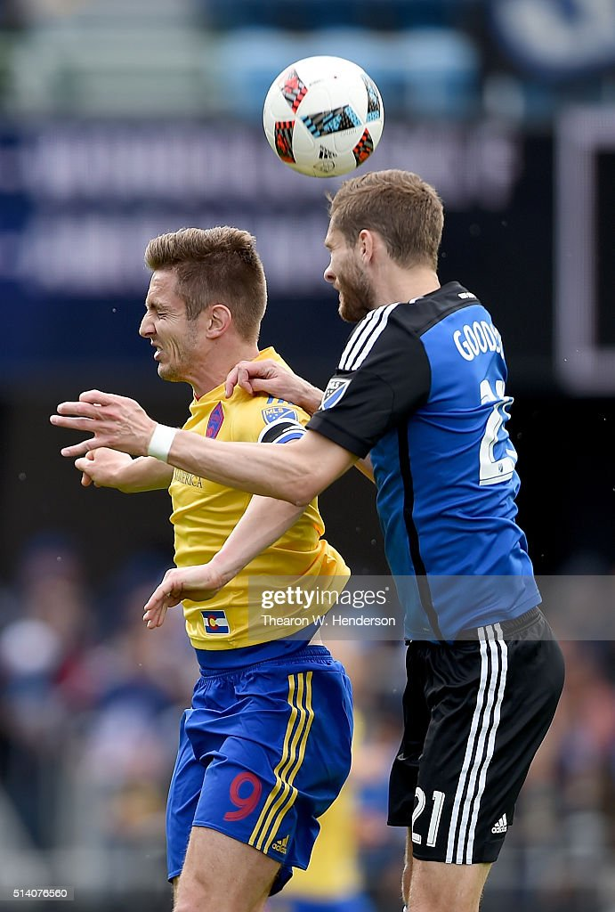 Clarence Goodson of San Jose Earthquakes hits a header over the top of Kevin Doyle of Colorado Rapids during the second half of their MLS Soccer game...