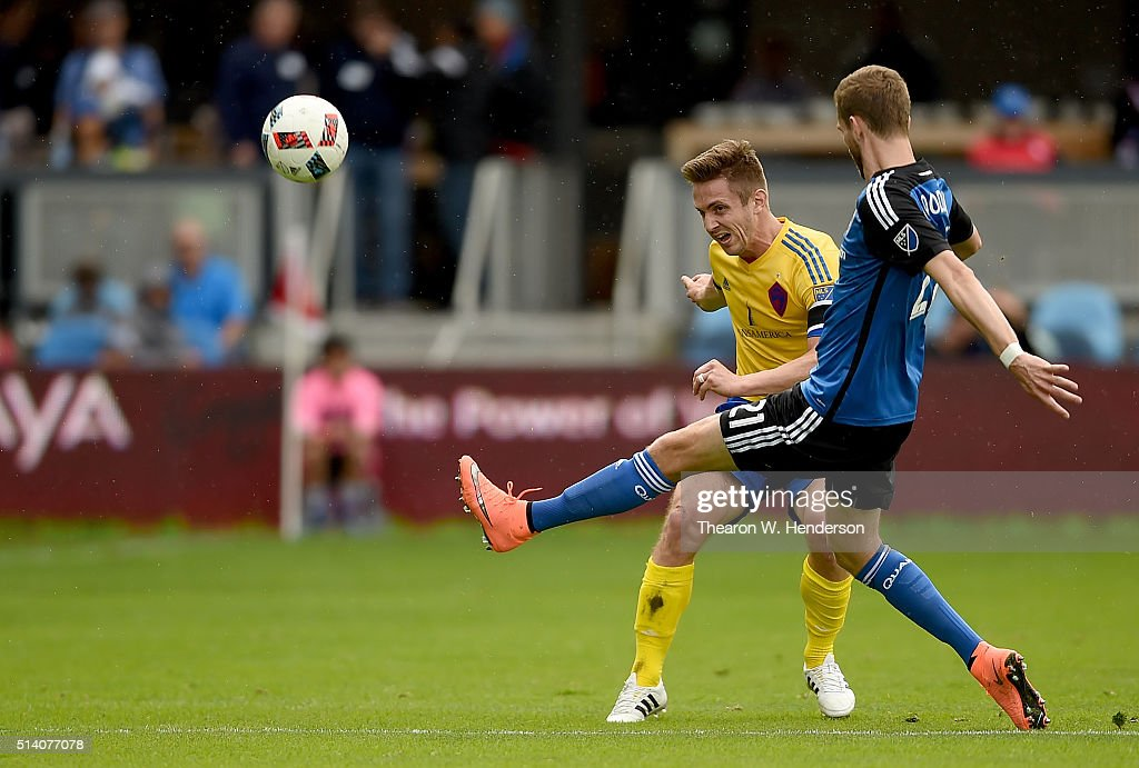 Clarence Goodson of San Jose Earthquakes kicks the ball away from Kevin Doyle of Colorado Rapids during the second half of their MLS Soccer game at...