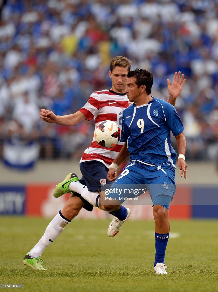 Clarence Goodson of the United States battles for the ball against Rafael Burgos of El Salvador in the second half during the 2013 CONCACAF Gold Cup...