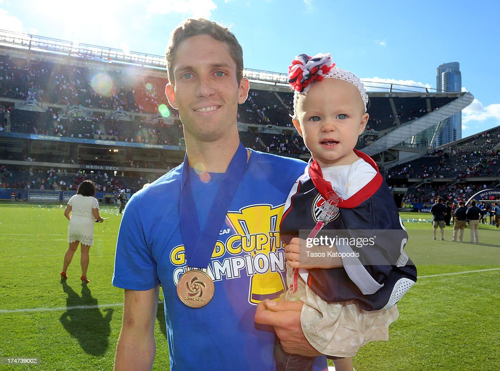 Clarence Goodson of the USA celebrates with his daughter after a win over Panama during the CONCACAF Gold Cup final match at Soldier Field on July 28...