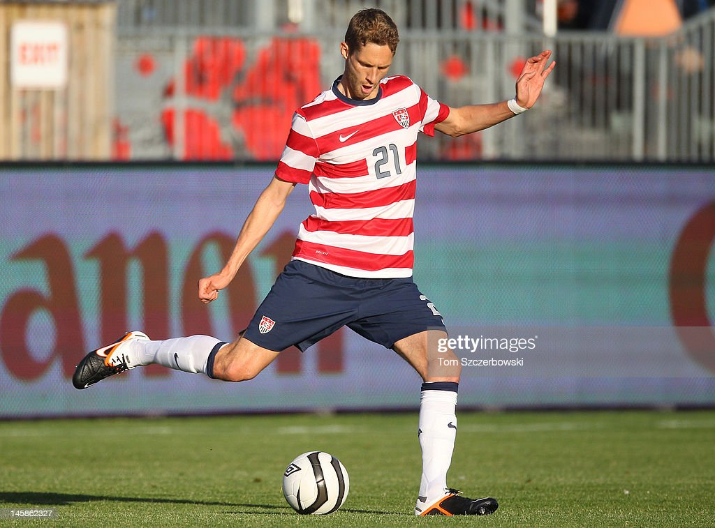 <a gi-track='captionPersonalityLinkClicked' href=/galleries/search?phrase=Clarence+Goodson&family=editorial&specificpeople=2334063 ng-click='$event.stopPropagation()'>Clarence Goodson</a> #21 of USA advances the ball against Canada during their international friendly match on June 3, 2012 at BMO Field in Toronto, Ontario, Canada.