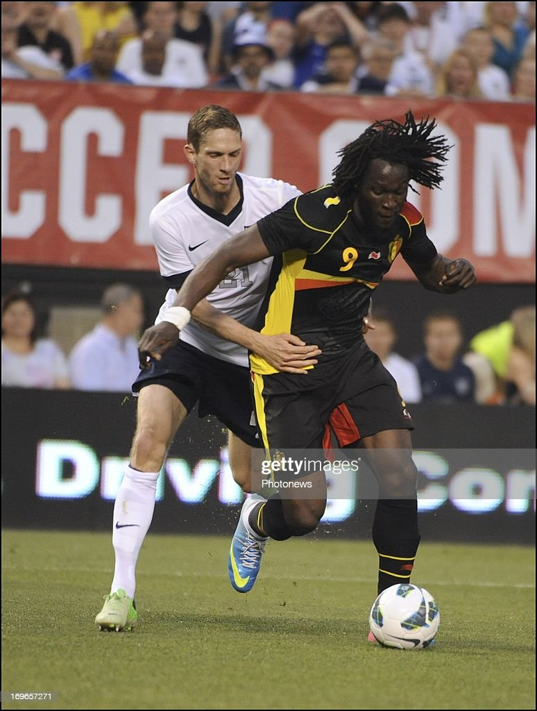 Clarence Goodson of USA and Romelu Lukaku of Belgium fight for the ball during the friendly match at First Energy Stadium May 29 2013 in Cleveland...