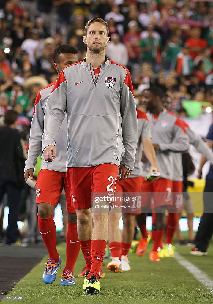 Clarence Goodson of USA leads teammates onto the field before the International Friendly against Mexico at University of Phoenix Stadium on April 2...