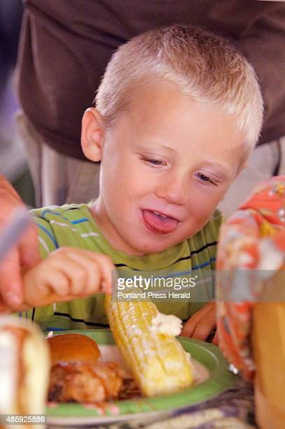 Clarence Leach butters his corn on the cob at a free community dinner at Fryeburg Academy in Fryeburg on Tuesday night The free dinner for 600 was...