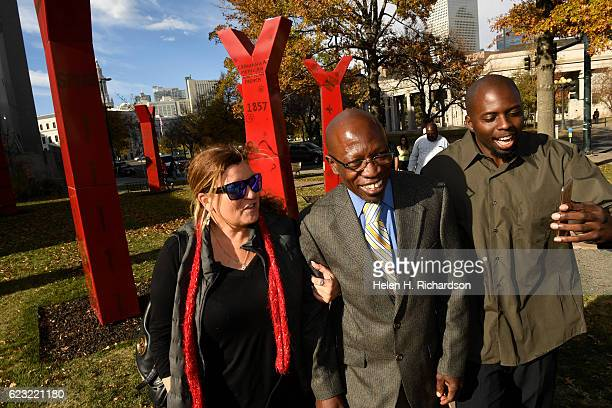 Clarence MosesEL middle walks as a free man with his girlfriend Lauren Gaspar left and former cellmate Robert Hawkins on November 14 2016 in Denver...