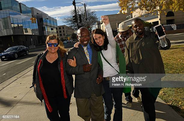 Clarence MosesEL walks as a free man with his girlfriend Lauren Gaspar left journalist Susan Greene and former cellmate Robert Hawkins right outside...