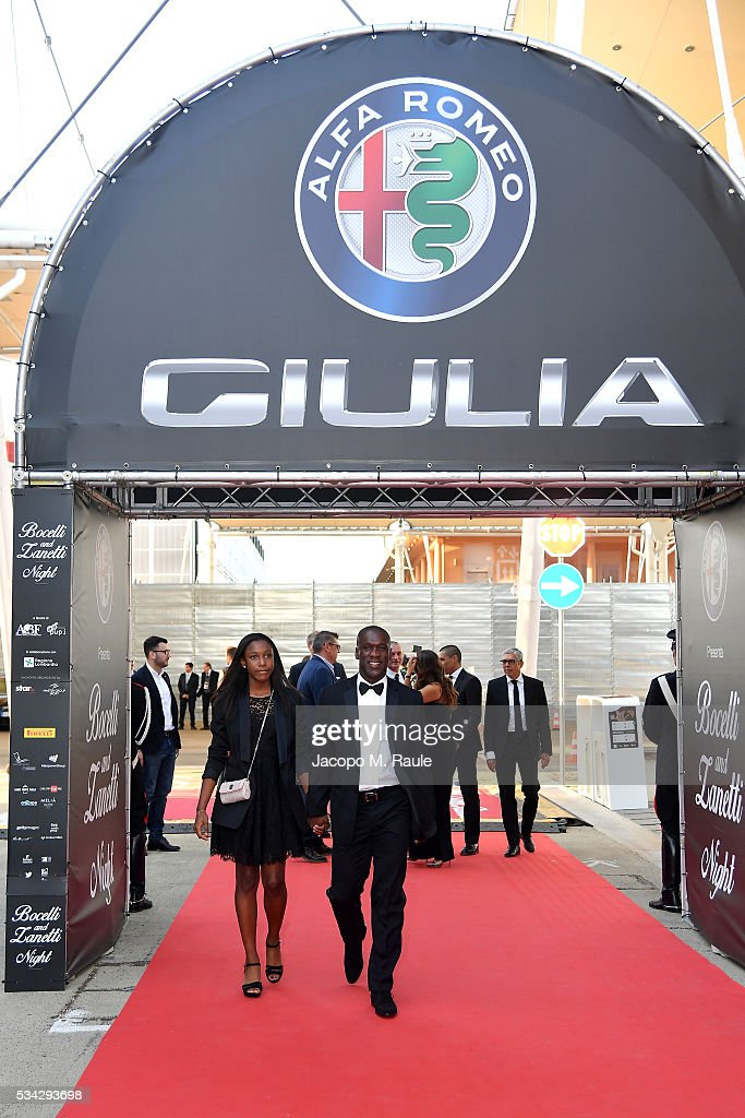 <a gi-track='captionPersonalityLinkClicked' href=/galleries/search?phrase=Clarence+Seedorf&family=editorial&specificpeople=208215 ng-click='$event.stopPropagation()'>Clarence Seedorf</a> and Luviana Seedorf arrive at Bocelli and Zanetti Night on May 25, 2016 in Rho, Italy.
