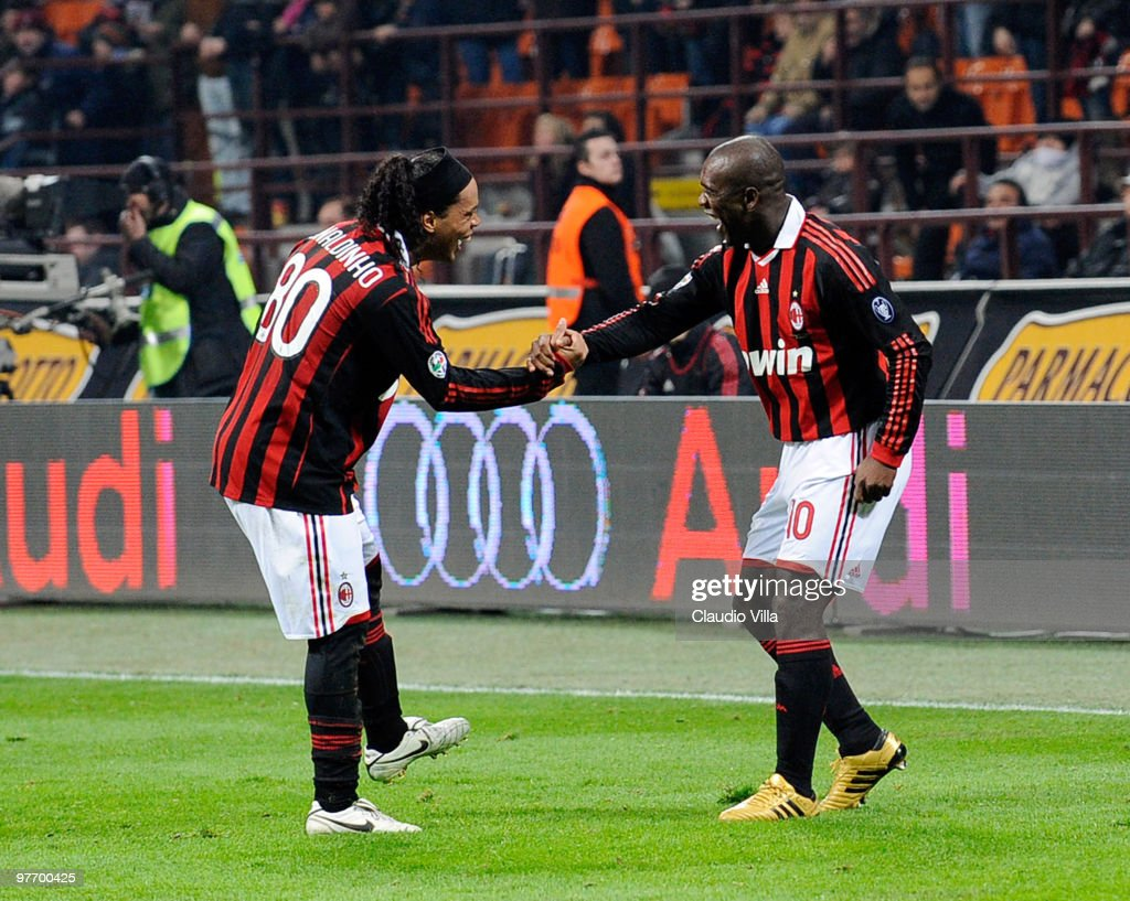 Clarence Seedorf and Ronaldinho of AC Milan celebrate after scoring the goal during the Serie A match between AC Milan and AC Chievo Verona at Stadio Giuseppe Meazza on March 14, 2010 in Milan, Italy.