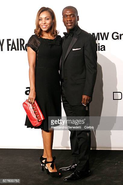 Clarence Seedorf and wife on the AmfAR Milano 2009 red carpet during the inaugural Milan Fashion Week event at La Permanente