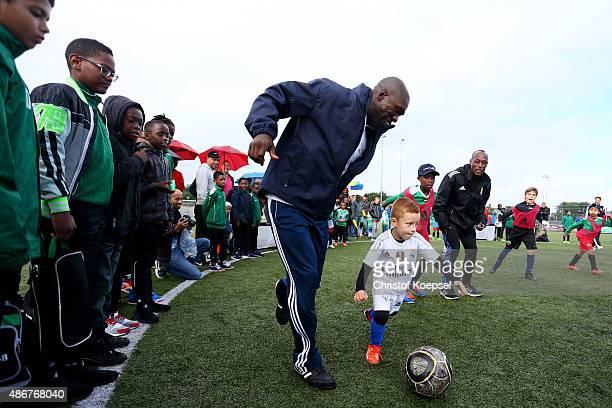 Clarence Seedorf Laureus the Netherlands trustee plays with kids prior to the Laureus KickOffForGood Charity Match between Laureus All Stars against...