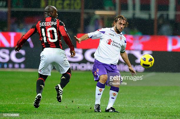 Clarence Seedorf of AC Milan and Marco Donadel of ACF Fiorentina compete for the ball during the Serie A match between Milan and Fiorentina at Stadio...
