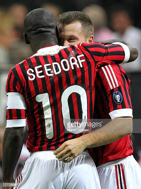Clarence Seedorf of AC Milan celebrates after scoring the opening goal with teammate Antonio Cassano during the Serie A match between AC Milan and AC...