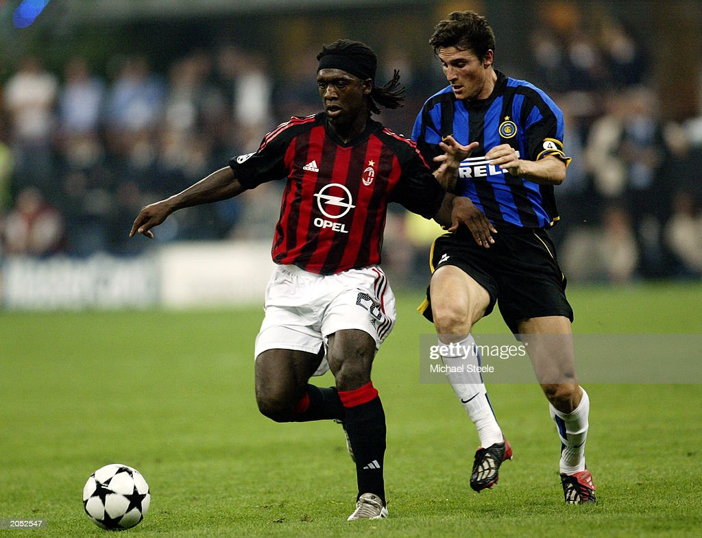 Clarence Seedorf of AC Milan and Javier Zanetti of Inter Milan
