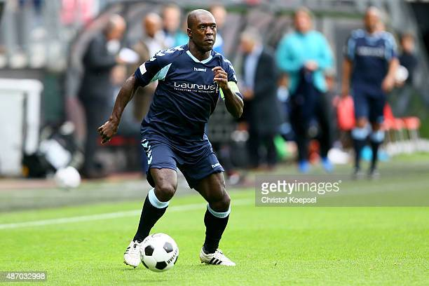 Clarence Seedorf of Laureus Allstaers runs with the ball during the Laureus KickOffForGood Charity Match between Laureus All Stars against Real...