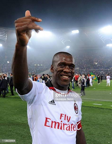 Clarence Seedorf of Milan celebrates the victory after the Serie A match between AS Roma and AC Milan at Stadio Olimpico on May 7 2011 in Rome Italy