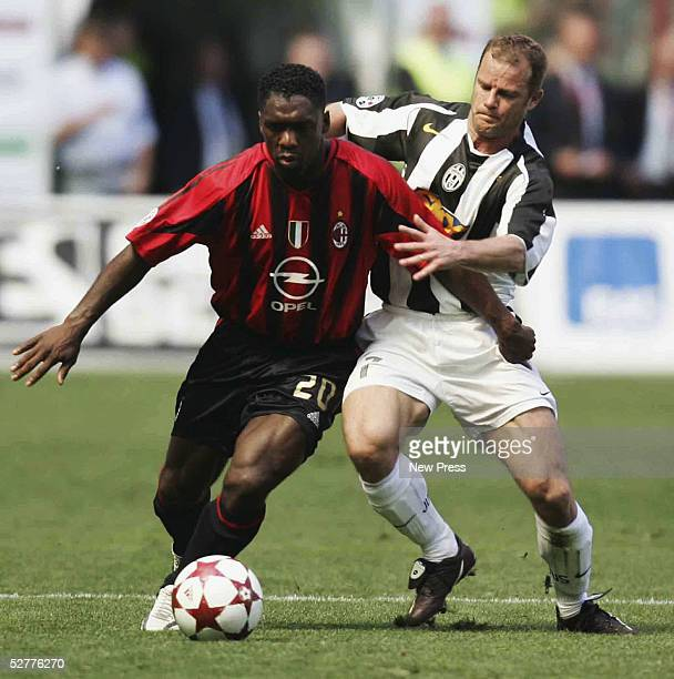 Clarence Seedorf of Milan holds off Gianluca Pessotto of Juventus during the Serie A match between AC Milan and Juventus played at the Guisseppe...