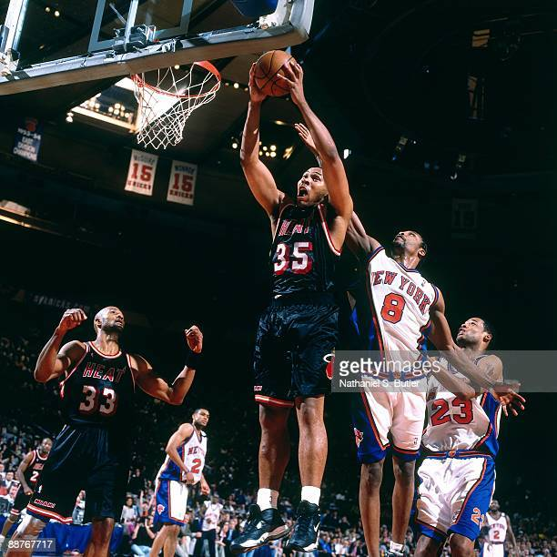 Clarence Weatherspoon of the Miami Heat grabs a rebound against Latrel Sprewell of the New York Knicks in Game Four of the Eastern Conference...