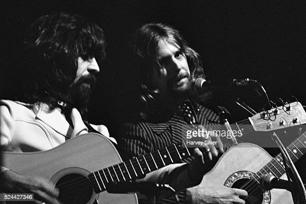 Clarence White and Roger McGuinn performing as The Byrds during a concert at Queens College in New York