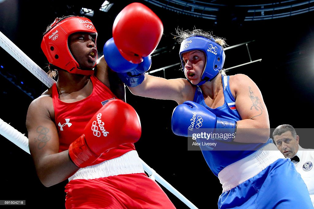 Claresa Maria Shields of the United States and Iaroslava Iakushina of Russia exchange blows during the Women's Middleweight Quarterfinal on Day 12 of...