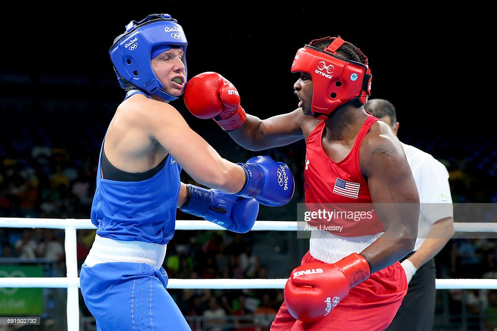 Claresa Maria Shields of the United States throws a right to the face of Iaroslava Iakushina of Russia by points during the Women's Middleweight...