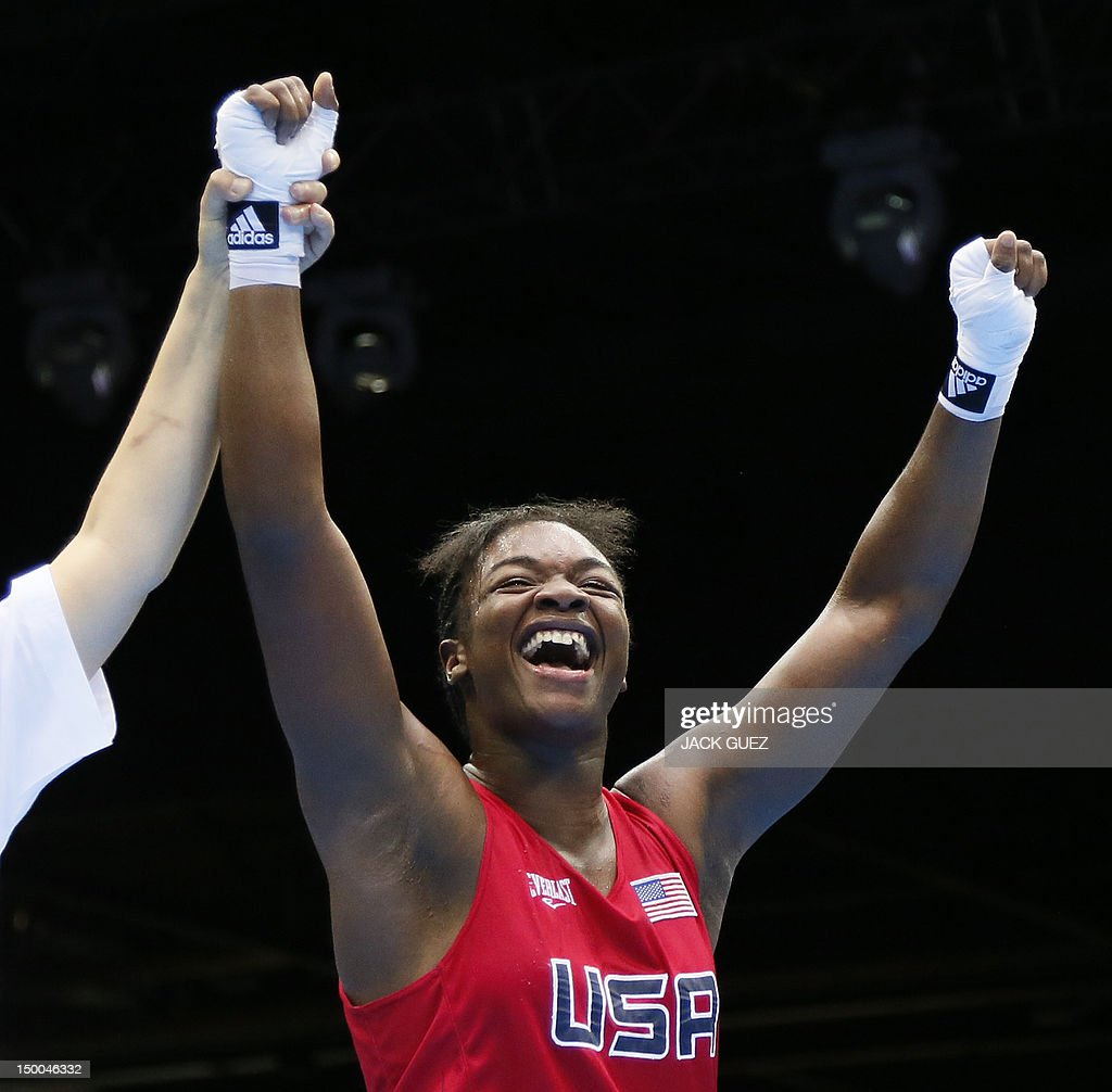 Claressa Shields of the USA celebrates her gold medal victory over Nadezda Torlopova of Russia in the women's boxing Middleweight final of the 2012...