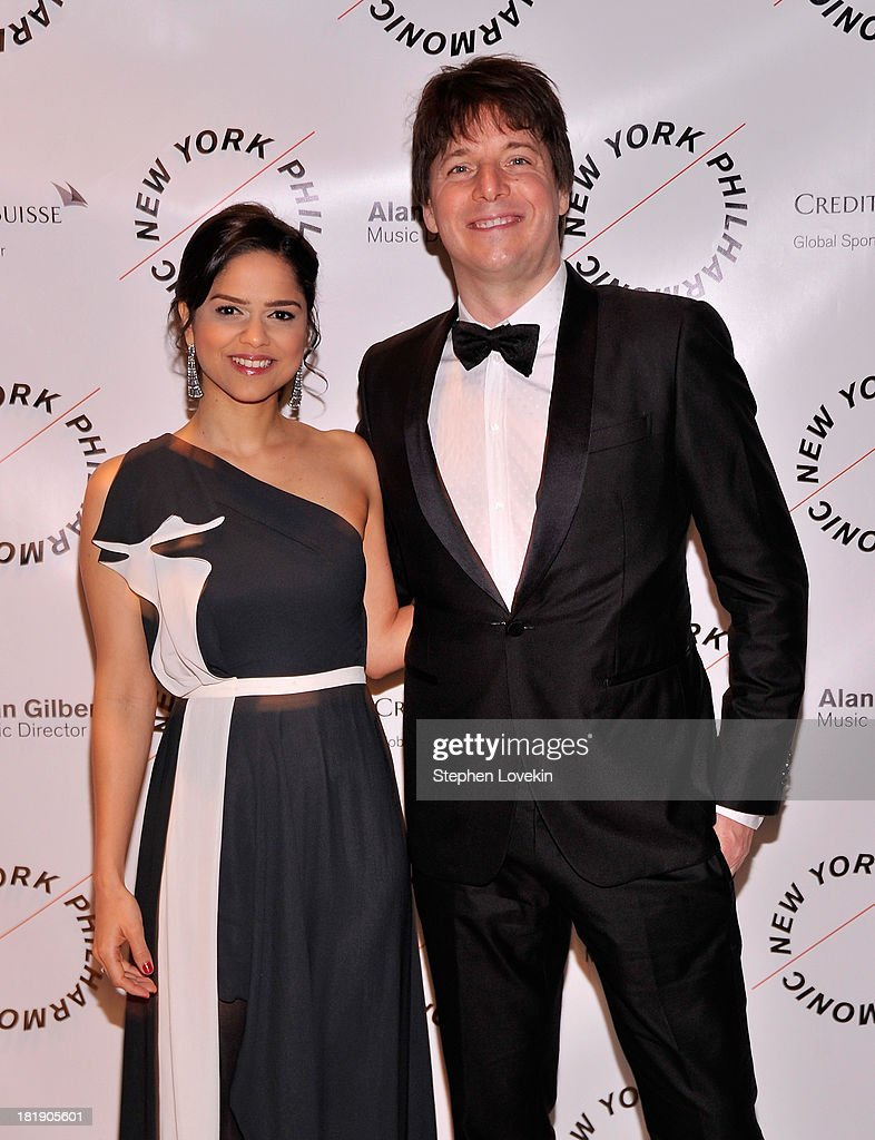 Clarisa Martinez and musician <a gi-track='captionPersonalityLinkClicked' href=/galleries/search?phrase=Joshua+Bell+-+M%C3%BAsico&family=editorial&specificpeople=556072 ng-click='$event.stopPropagation()'>Joshua Bell</a> attend The New York Philharmonic 172nd Season Opening Night Gala at Avery Fisher Hall, Lincoln Center on September 25, 2013 in New York City.