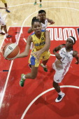 Clarissa Cristina Dos Santos of the Brazil National Team shoots against Crystal Langhorne of the Washington Mystics at the Verizon Center on May 15...