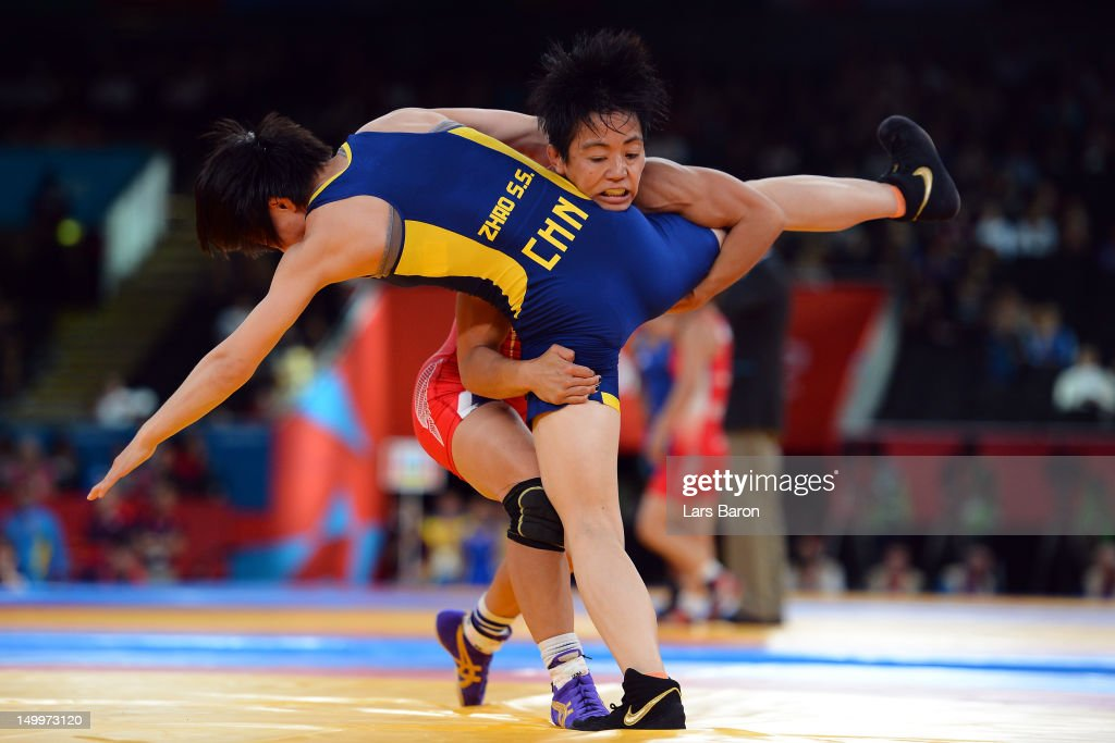 Clarissa Kyoko Mei Ling Chun of United States (red) competes against Shasha Zhao of China (blue) in the Women's Freestyle 48 kg Wrestling on Day 12 of the London 2012 Olympic Games at ExCeL on August 8, 2012 in London, England.