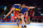 Clarissa Kyoko Mei Ling Chun of United States competes against Shasha Zhao of China in the Women's Freestyle 48 kg Wrestling on Day 12 of the London...
