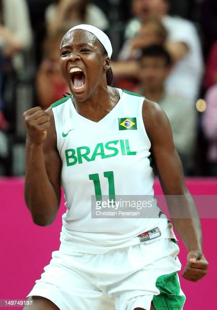 Clarissa Santos of Brazil reacts after scoring against Canada late in the third quarter of the Women's Basketball Preliminary Round match on Day 7 of...