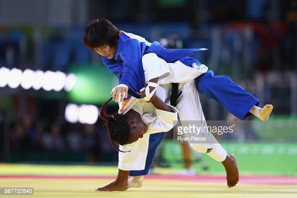 Clarisse Agbegnenou of France and Miku Tashiro of Japan compete during the Women's 63kg semifinal bout on Day 4 of the Rio 2016 Olympic Games at the...