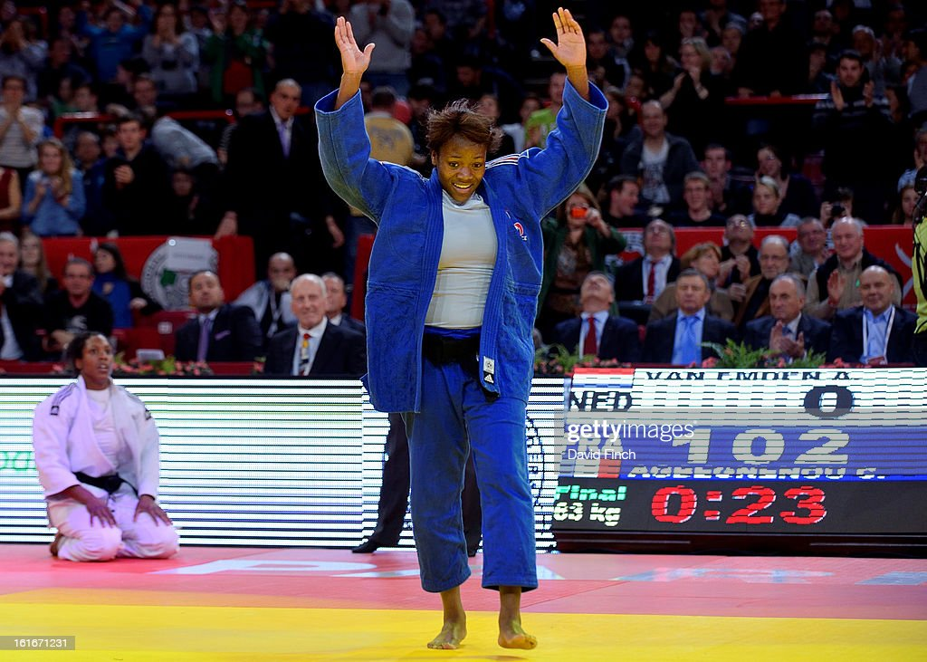 Clarisse Agbegnenou of France (blue) celebrates her victory after throwing and then holding Anicka Van Emden of Holland for ippon (10 points) during the u63kgs final at the Paris Grand Slam on day 1, Saturday, February 09, 2013 at the Palais Omnisports de Paris, Bercy, Paris, France.