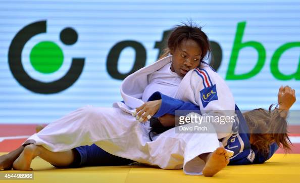 Clarisse Agbegnenou of France holds Mungunchimeg Baldorj of Mongolia for ippon helping the French team to win the women's gold medal during the...