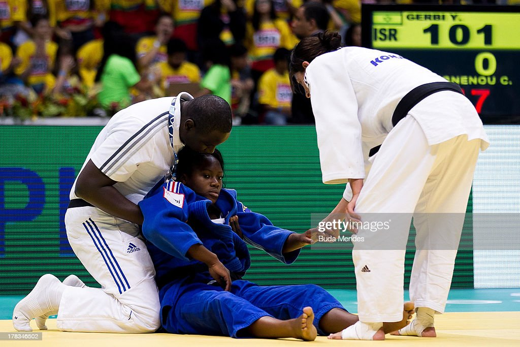 Clarisse Agbegnenou of France (C) is assisted during the women's -63kg category final against Yarden Gerbi of Israel during the World Judo Championships at Gymnasium Maracanazinho on August 29, 2013 in Rio de Janeiro, Brazil.