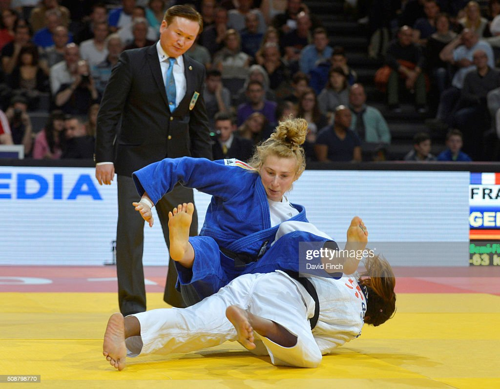 Clarisse Agbegnenou of France throws Martyna Trajdos of Germany for an ippon to reach the u63kg final and the gold medal during the 2016 Paris Judo...