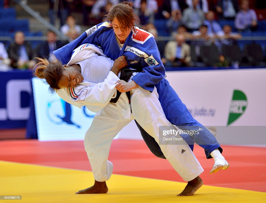 Clarisse Agbegnenou of France (white) throws Yarden Gerbi of Israel for an ippon (10 points) to win the u63kg gold medal during the Chelyabinsk Judo World Championships at the Sport Arena 'Traktor' on August 28, 2014 in Chelyabinsk, Russia.