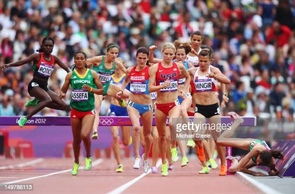 Clarisse Cruz of Portugal falls as she compete in the Women's 3000m Steeplechase Round 1 Heatson Day 8 of the London 2012 Olympic Games at Olympic...