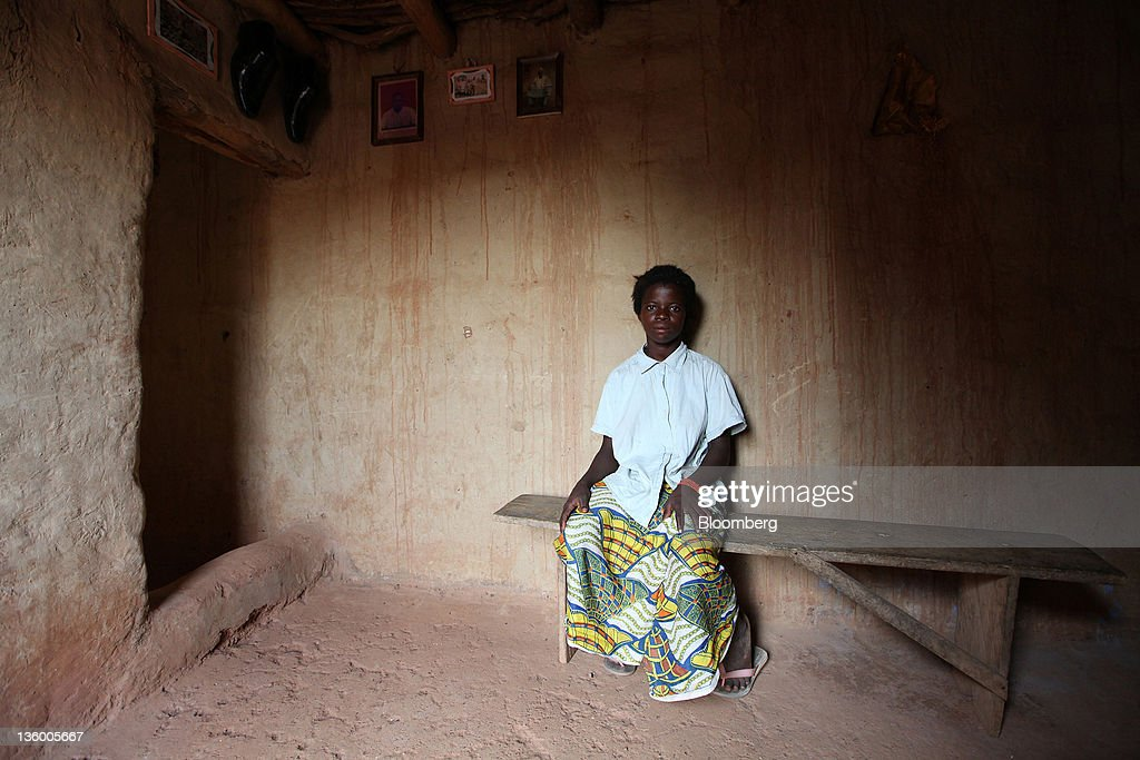 Clarisse Kambire, 13, a child laborer, poses for a photograph in the room where she sleeps in Benvar, Burkina Faso, on Friday, Nov. 11, 2011. In Burkina Faso, one of the poorest countries in the world, where child labor is endemic to the production of its chief crop export, paying lucrative premiums for organic and fair traden cotton has -- perversely -- created fresh incentives for exploitation. Photographer: Chris Ratcliffe/Bloomberg via Getty Images