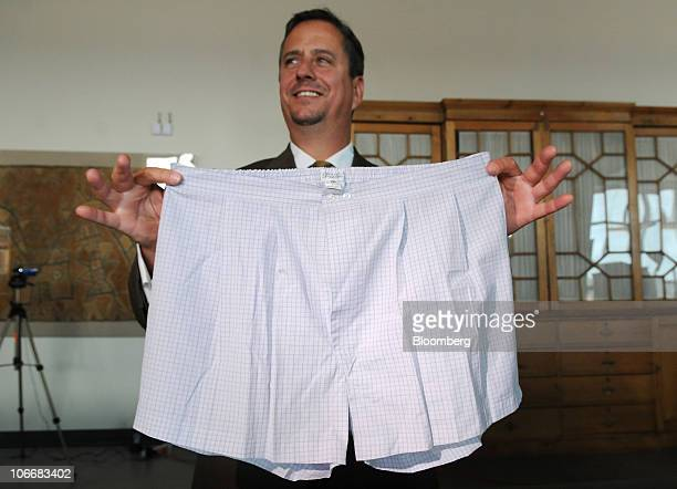 Clark Carr of Gaston Sheehan auctioneers displays a pair of pleated men's boxer shorts that belonged to Bernard Madoff during a media preview of the...