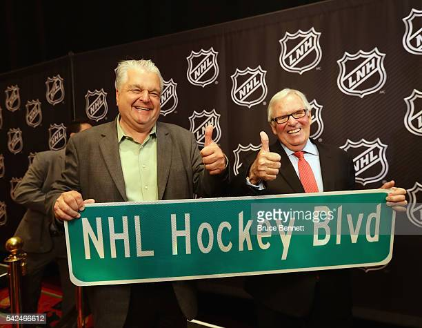 Clark County Commissioner Steve Sisolak and Bill Foley celebrate the admittance of a new NHL franchise during the Board Of Governors Press Conference...