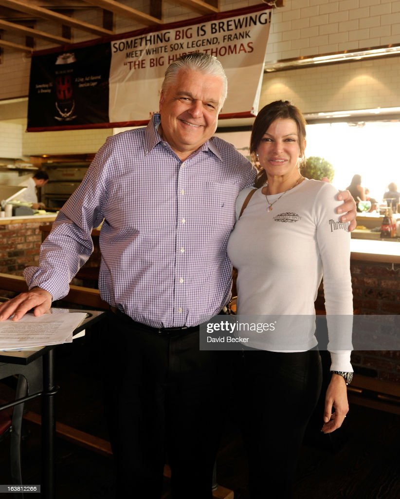 Clark County Commissioner Steve Sisolak (L) and chef Carla Pellegrino at the Meatball Spot on March 16, 2013 in Las Vegas, Nevada.
