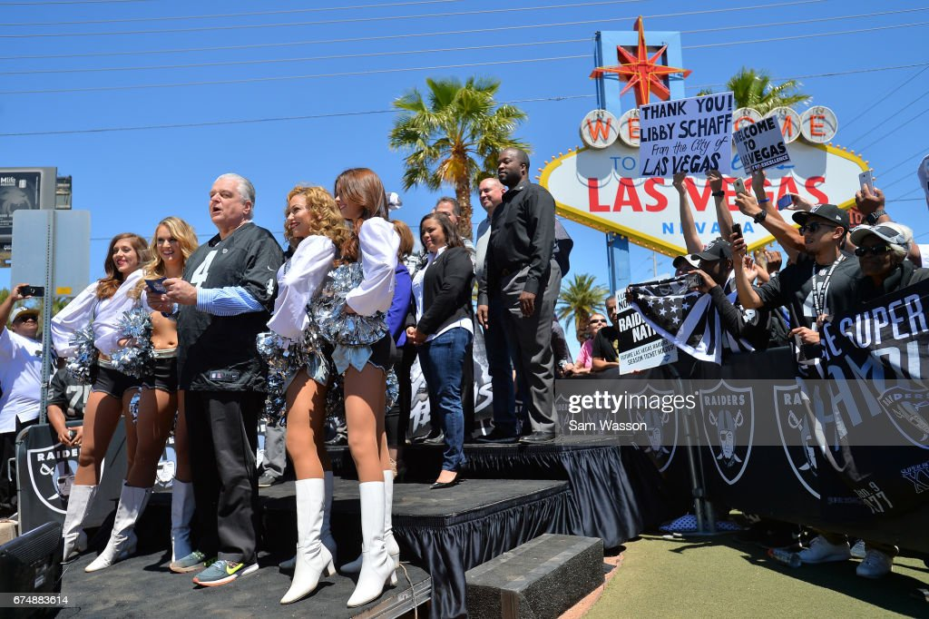 Clark County Commissioner Steve Sisolak (L) announces Marquel Lee of Wake Forest as the Oakland Raiders' fifth-round draft pick during the team's 2017 NFL Draft event at the Welcome to Fabulous Las Vegas sign on April 29, 2017 in Las Vegas, Nevada. National Football League owners voted in March to approve the team's application to relocate to Las Vegas. The Raiders are expected to begin play no later than 2020 in a planned 65,000-seat domed stadium to be built in Las Vegas at a cost of about USD 1.9 billion.