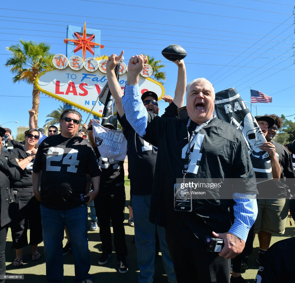 Clark County Commissioner Steve Sisolak (R, front) leads Oakland Raiders fans in a cheer during the team's 2017 NFL Draft event at the Welcome to Fabulous Las Vegas sign on April 29, 2017 in Las Vegas, Nevada. National Football League owners voted in March to approve the team's application to relocate to Las Vegas. The Raiders are expected to begin play no later than 2020 in a planned 65,000-seat domed stadium to be built in Las Vegas at a cost of about USD 1.9 billion.