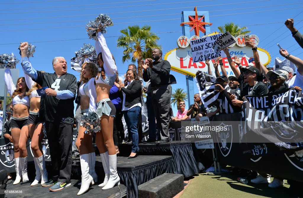 Clark County Commissioner Steve Sisolak (L) leads Oakland Raiders fans in a cheer after annoucing the team's fifth-round draft pick at the Welcome to Fabulous Las Vegas sign on April 29, 2017 in Las Vegas, Nevada. National Football League owners voted in March to approve the team's application to relocate to Las Vegas. The Raiders are expected to begin play no later than 2020 in a planned 65,000-seat domed stadium to be built in Las Vegas at a cost of about USD 1.9 billion.