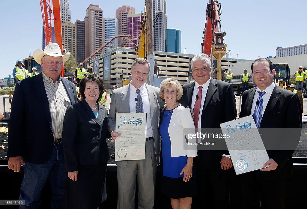 Clark County Commissioner Tom Collins, chairman of the Las Vegas Convention and Visitors Authority, Clark County Commissioner Mary Beth Scow, MGM Resorts International Chairman and CEO Jim Murren, Clark County Commissioners Steve Sisolak and Susan Brager and President and CEO of AEG Dan Beckerman hold proclamations as they attend a groundbreaking for a USD 375 million, 20,000-seat sports and entertainment arena being built by MGM Resorts International and AEG on May 1, 2014 in Las Vegas, Nevada. The arena is scheduled to open in early 2016.