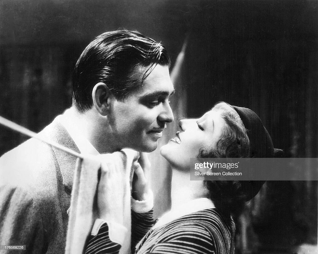 Clark Gable (1901 - 1960) and Claudette Colbert (1903 - 1996) in a publicity still for 'It Happened One Night', directed by Frank Capra, 1934.