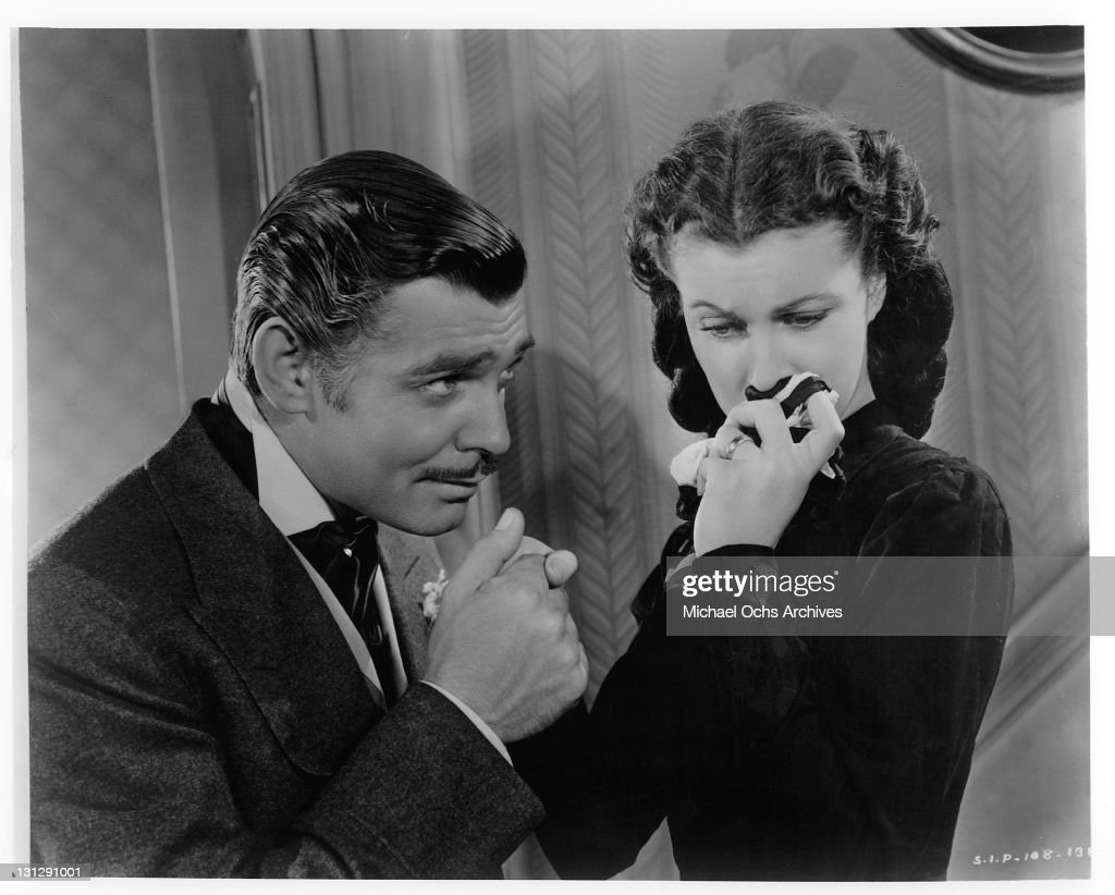 Clark Gable holding Vivien Leigh's hand as she sobs in a scene from the film 'Gone With The Wind' 1939